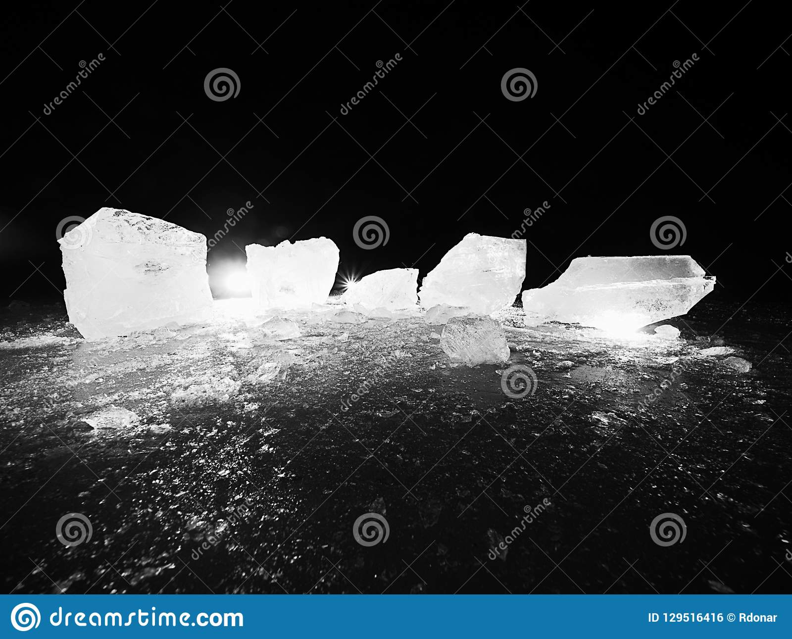 Piece of crushed ice on dark natural background. Authentic texture