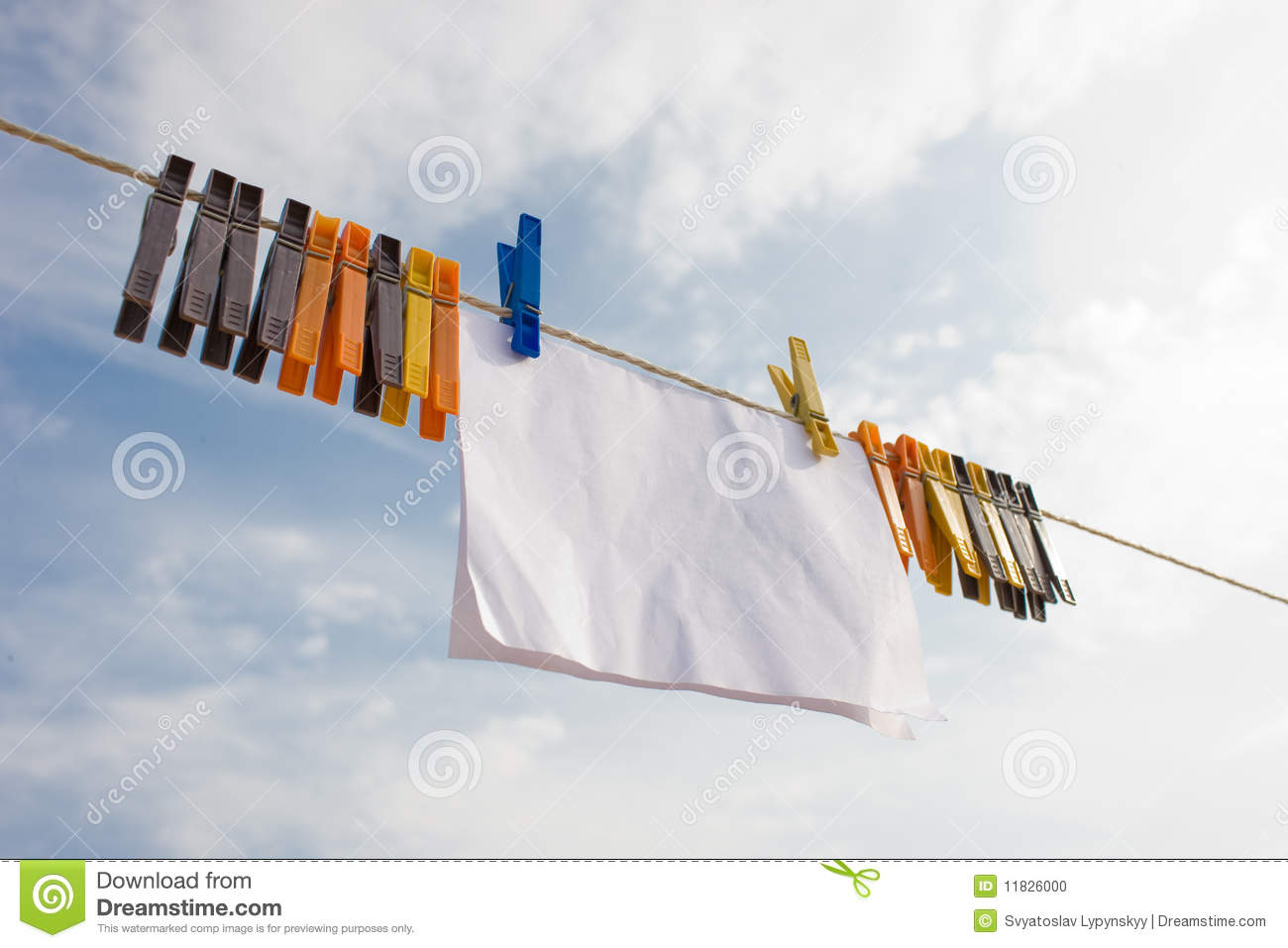 piece of paper hanging on cord with clothespins stock