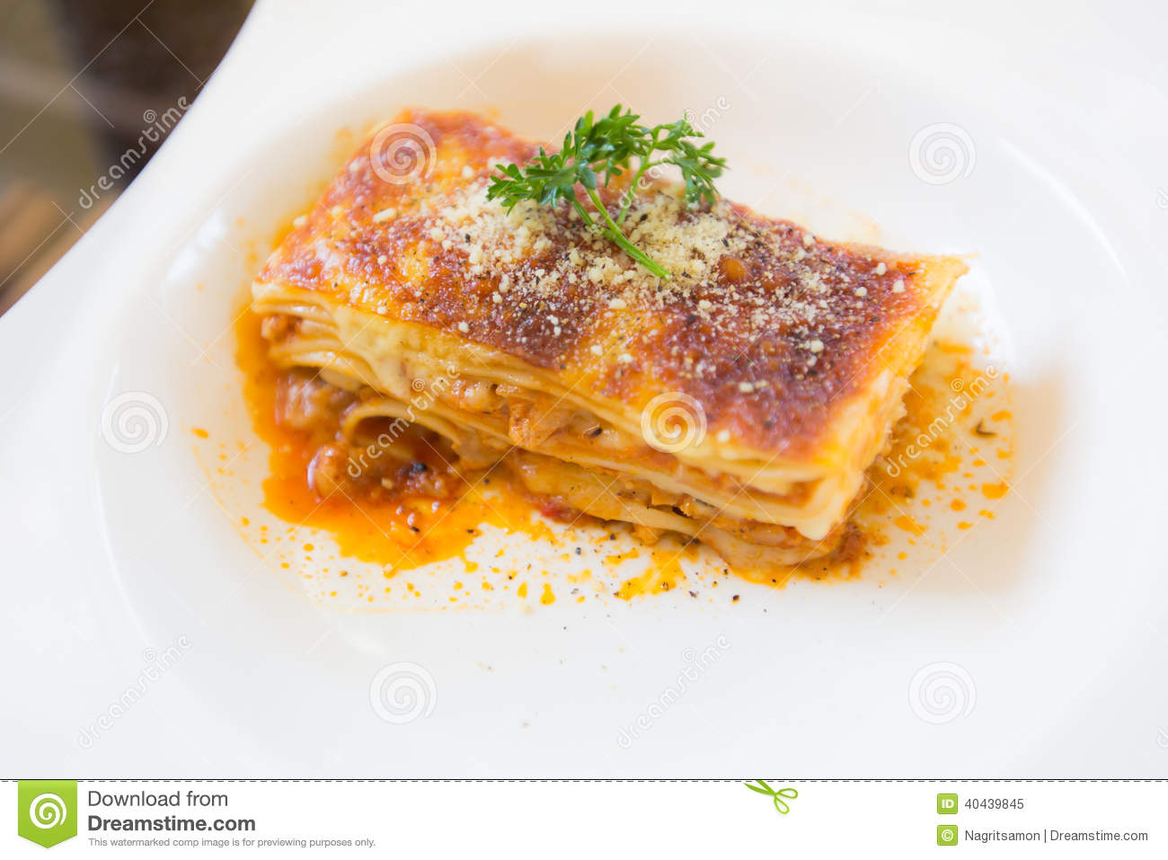 A Piece Of Pork And Tuna Lasagna With Parsley, Close Up ...