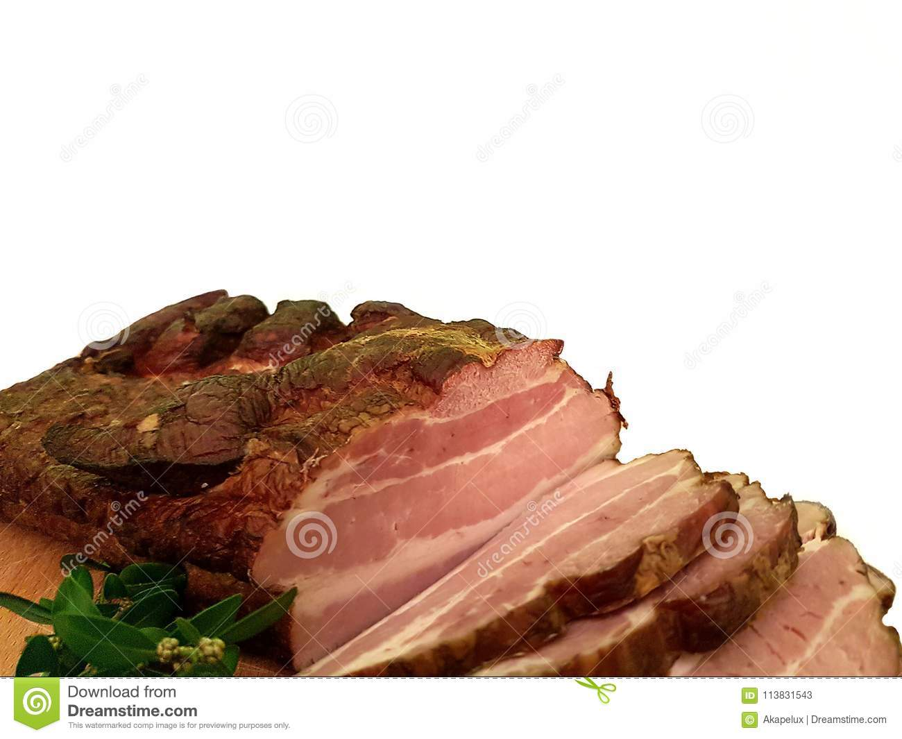 A piece of smoked sponge chopped on a wooden board decorated with a green plant. Fat high-protein high-calorie food. Taste for rea