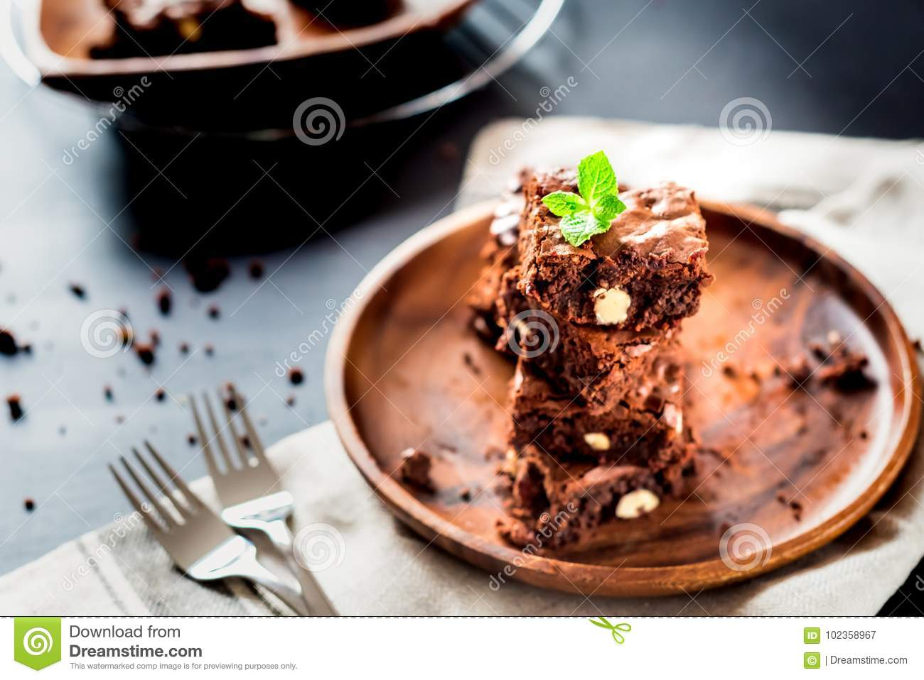 Homemade Dark Chocolate Brownies Slices And Mint On Wood Table With