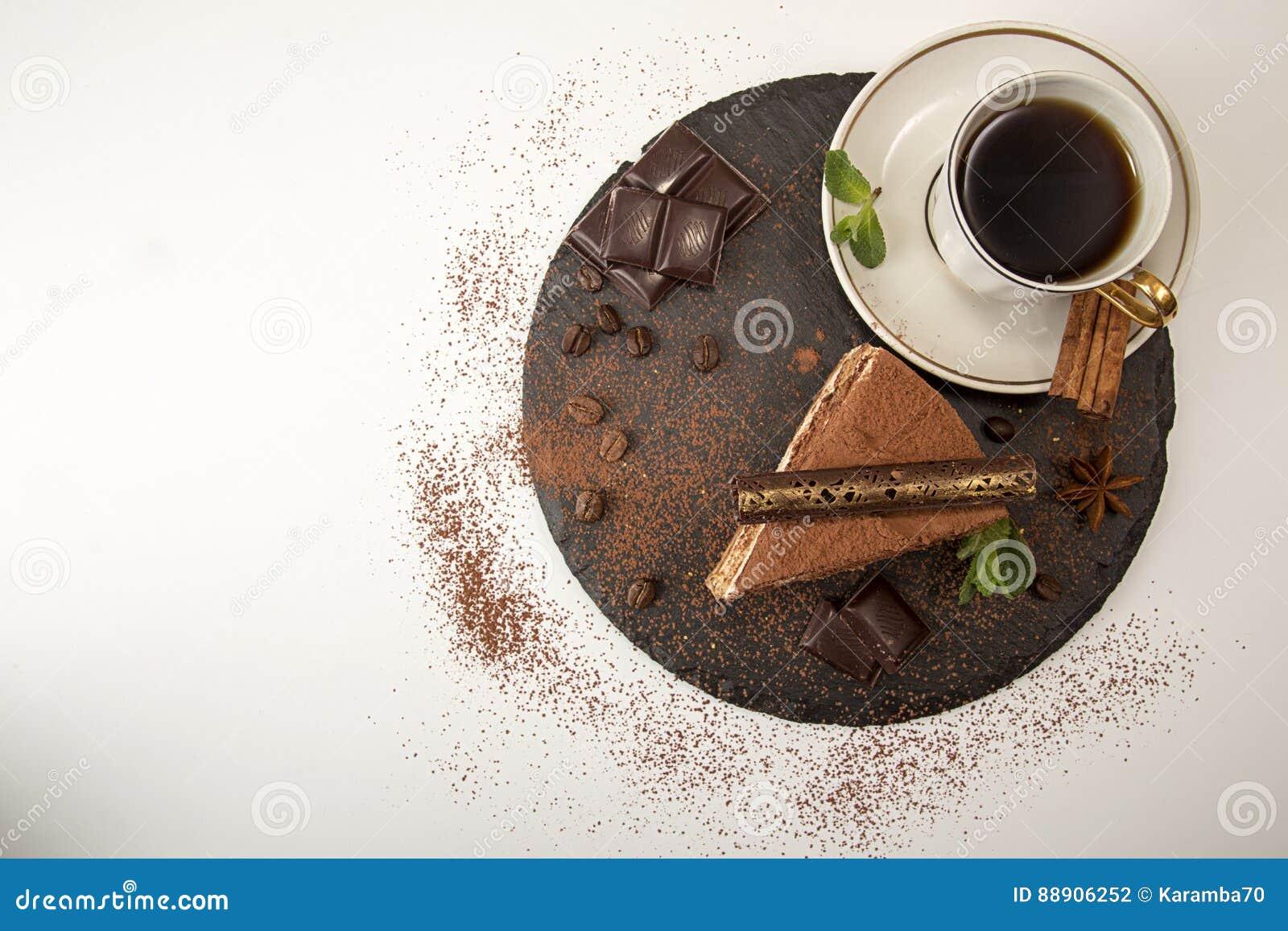 Piece of tiramisu cake on black slate