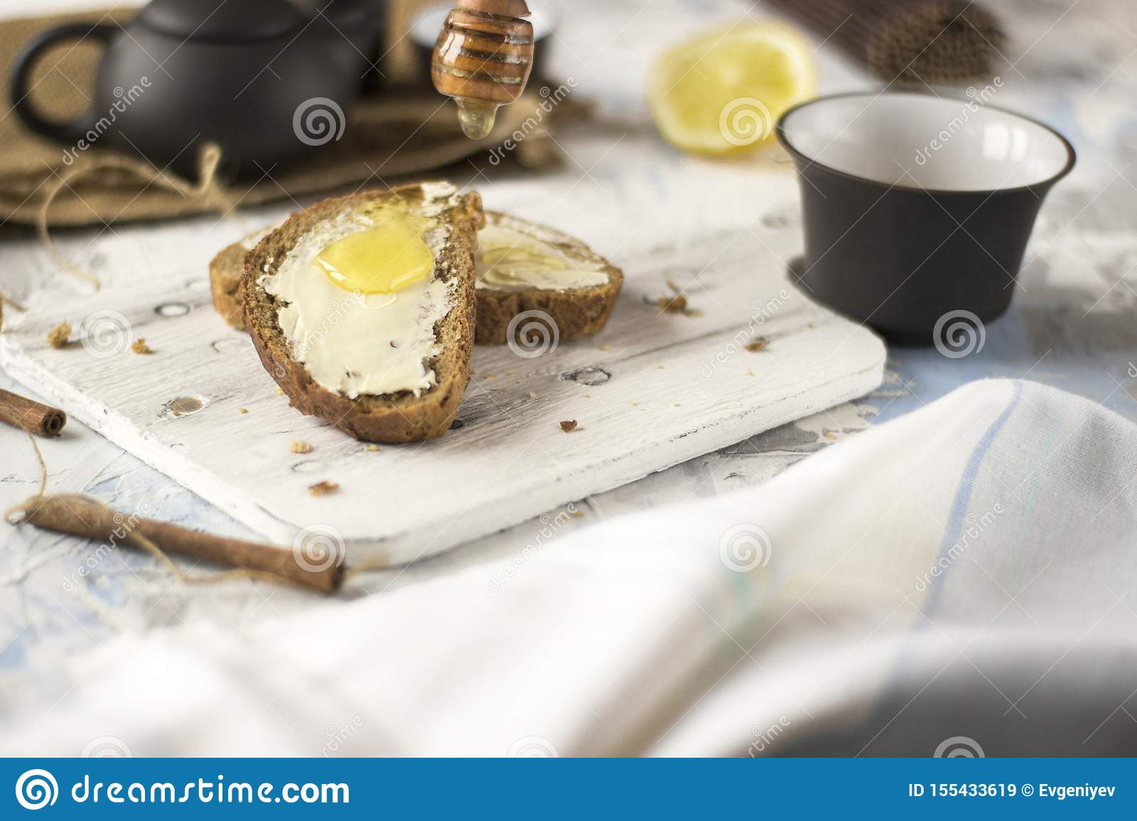Pieces of bread with butter and honey