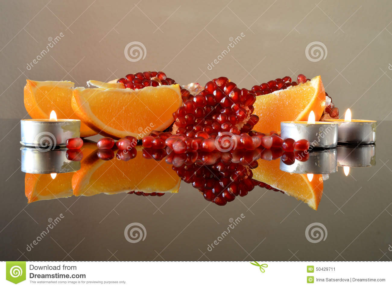 pieces-pomegranate-orange-wedges-candles-segments-glass-surface ...