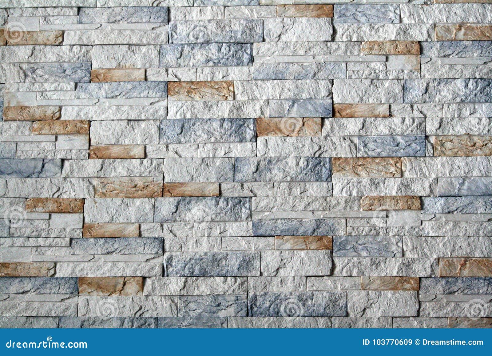 Piedras decorativas y ladrillos en la pared imagen de for Bolsa de piedras decorativas