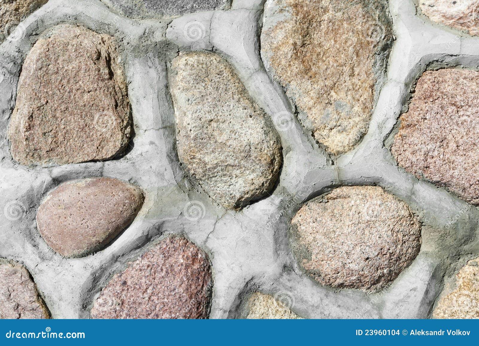 Piedras rojas del granito en pared imagenes de archivo for Granito en piedra