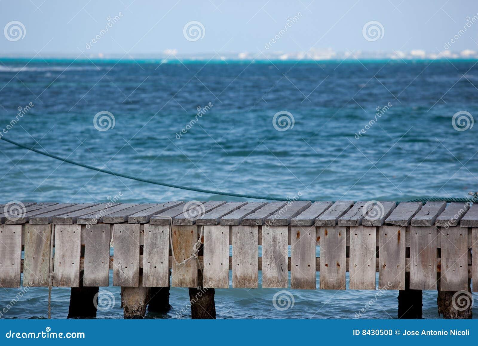 Pier by blue ocean