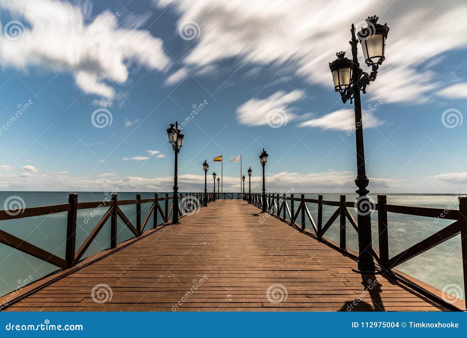 Pier on a beach in Marbella, Spain.