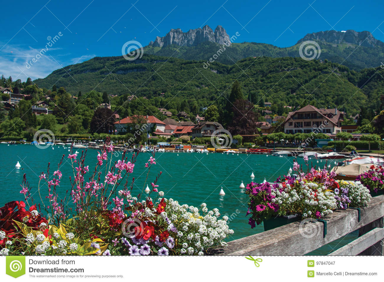 Pier with flowers on the lake of Annecy, in the village of Talloires.