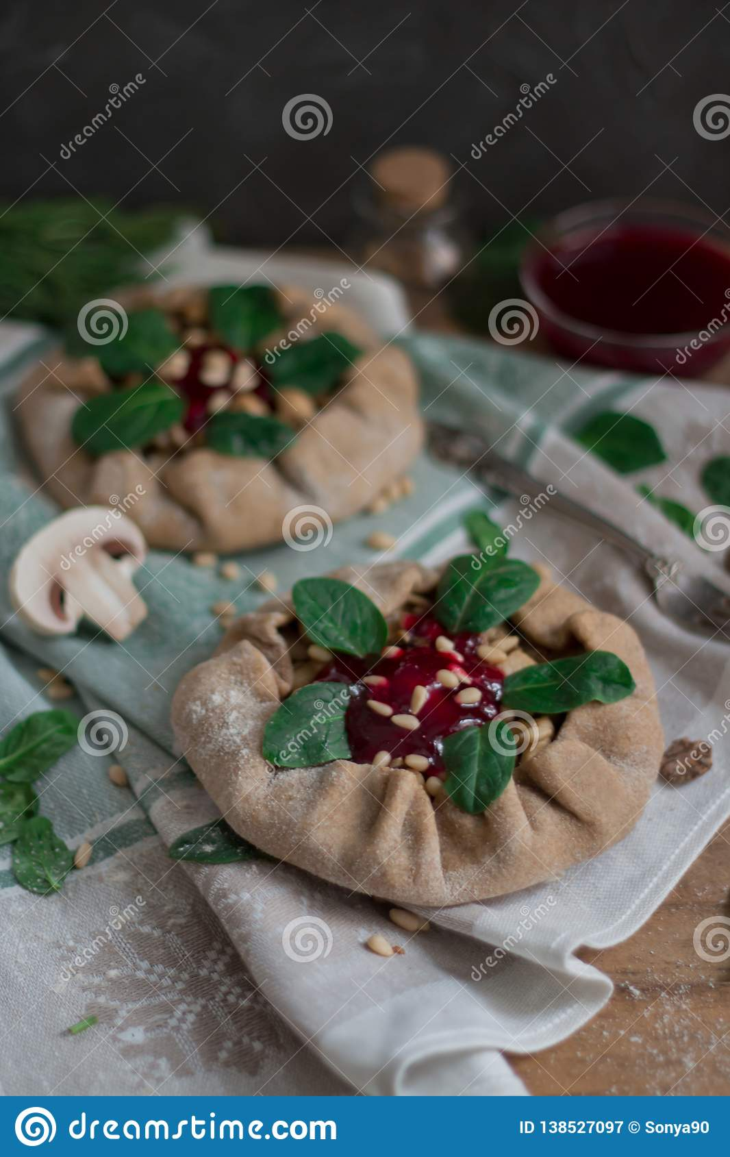 Pies with mushrooms, chicken, spinach, pine nuts and lingonberry sauce.