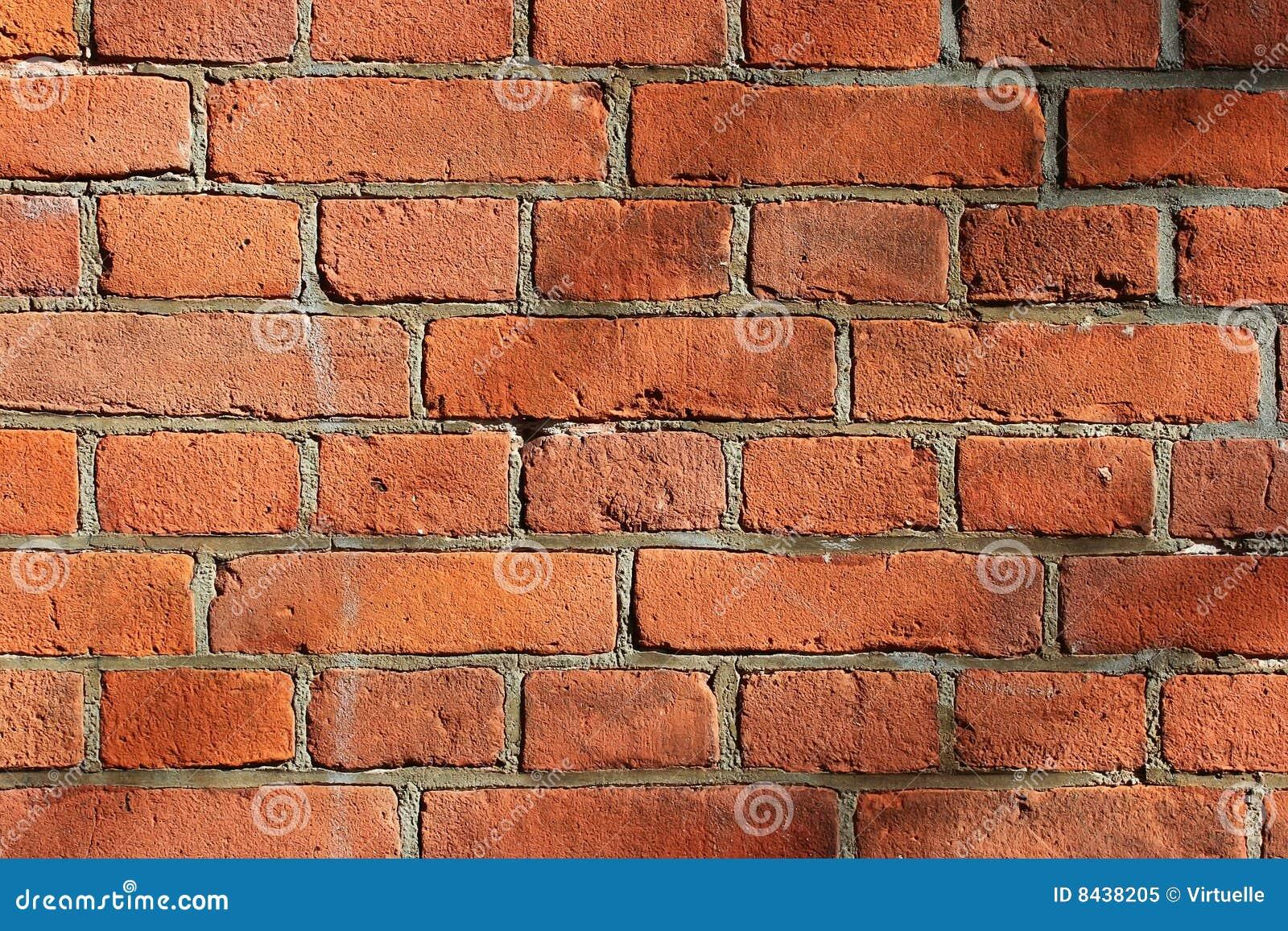 Pieza de una pared de piedra con los ladrillos rojos foto - Ladrillos de piedra ...