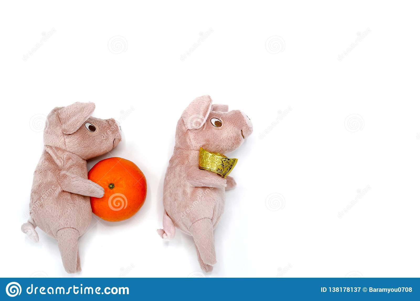 Pig doll with gold ingot and orange