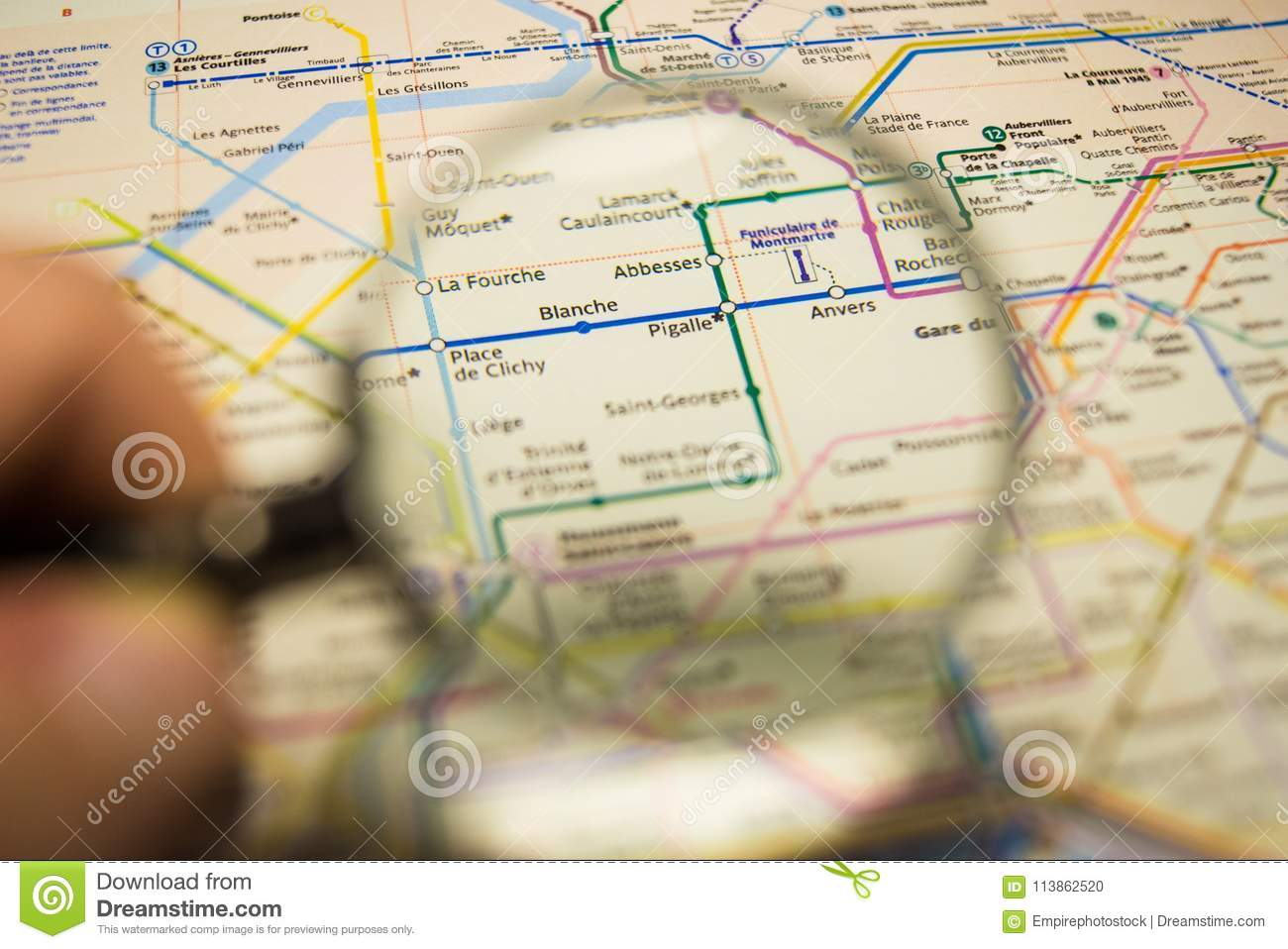 Pigalle Metro Station On A Printed Paris Metro Map Under A Magnifier