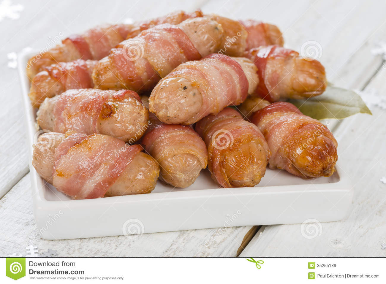 pigs in blankets sausages wrapped in bacon traditional british christmas dinner side dish - British Christmas Dinner