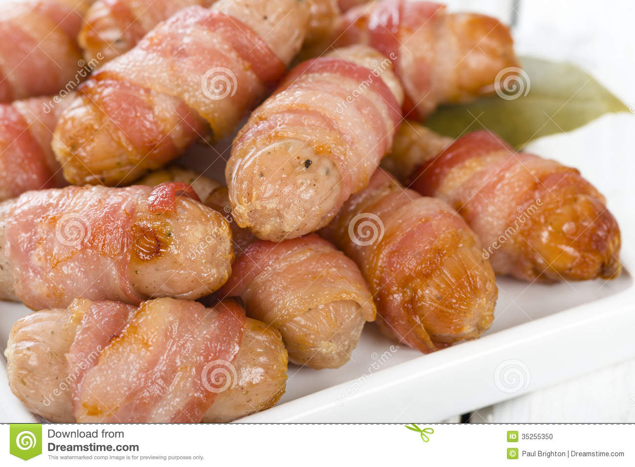 Pigs in Blankets - Sausages wrapped in bacon. Traditional British ...
