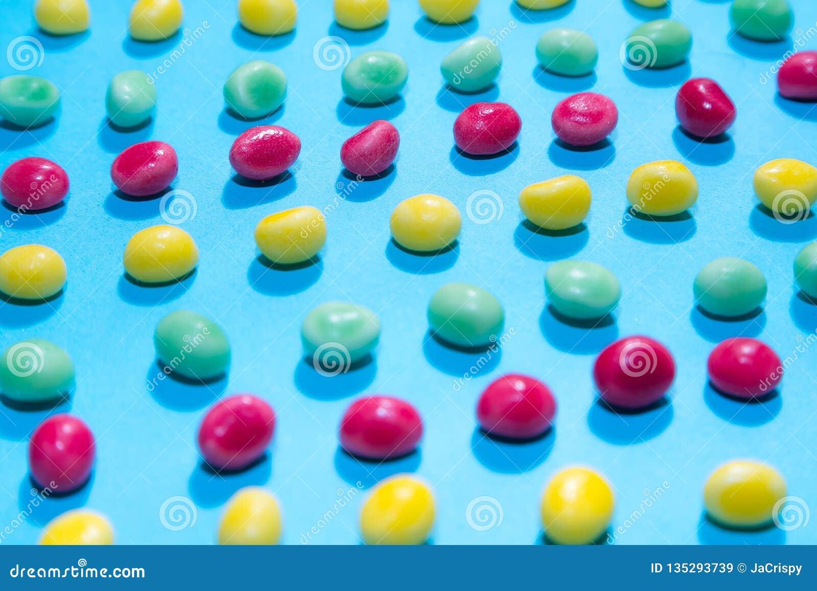 Pila de fondo de masticación colorido delicioso de los caramelos Dulces coloridos