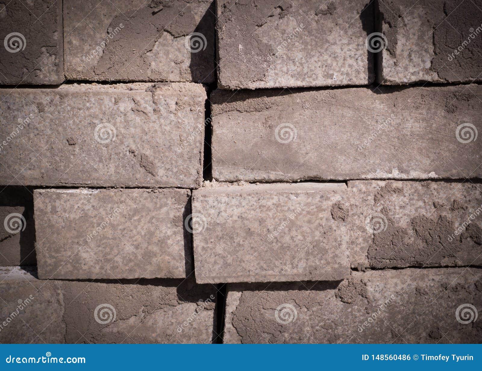 Pila di ciottoli della pavimentazione, mattoni struttura vignetted, costruzione