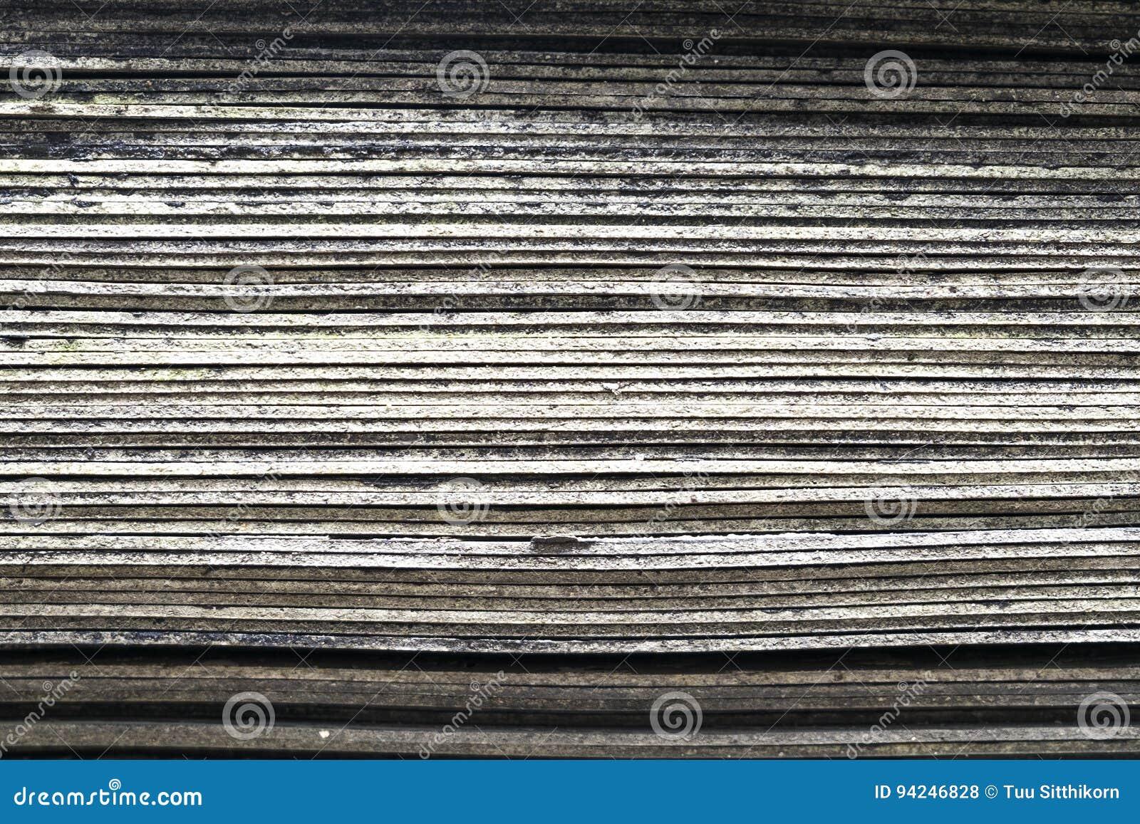 Pila di vecchia piastrella per pavimento di gomma strato