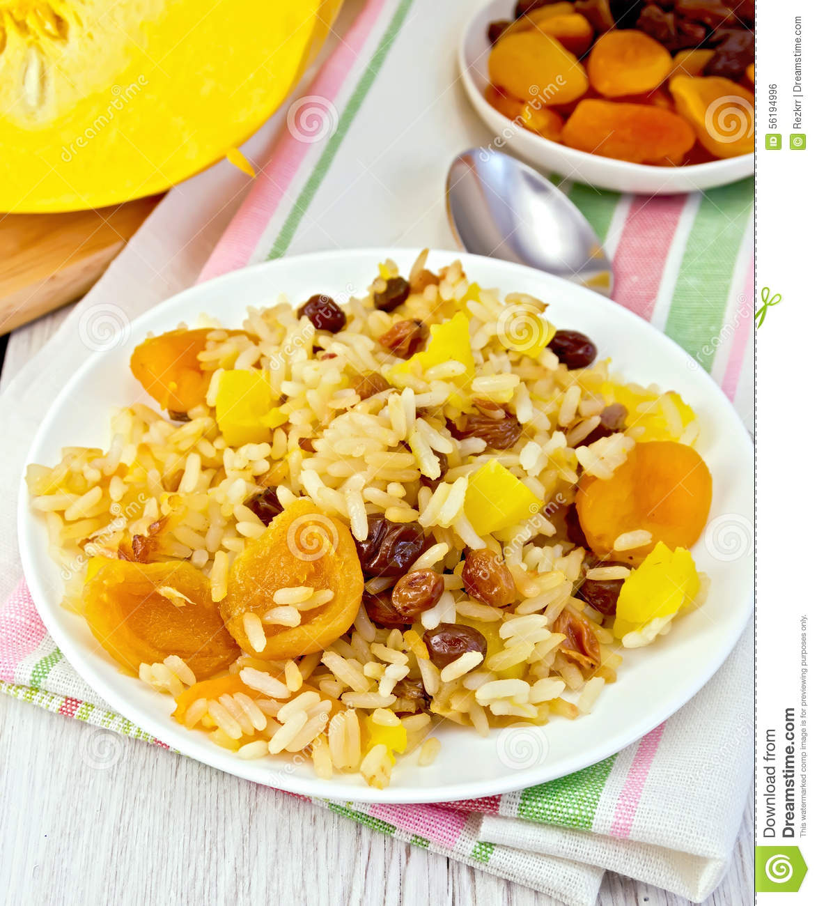 Pilaf fruit with pumpkin, raisins, dried apricots in a white plate on ...