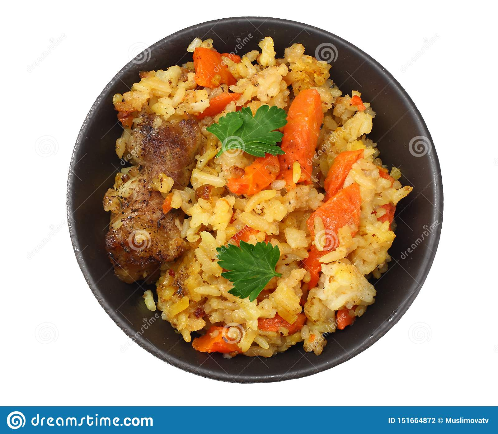 pilaf with meat on black plate isolated on white background. top view
