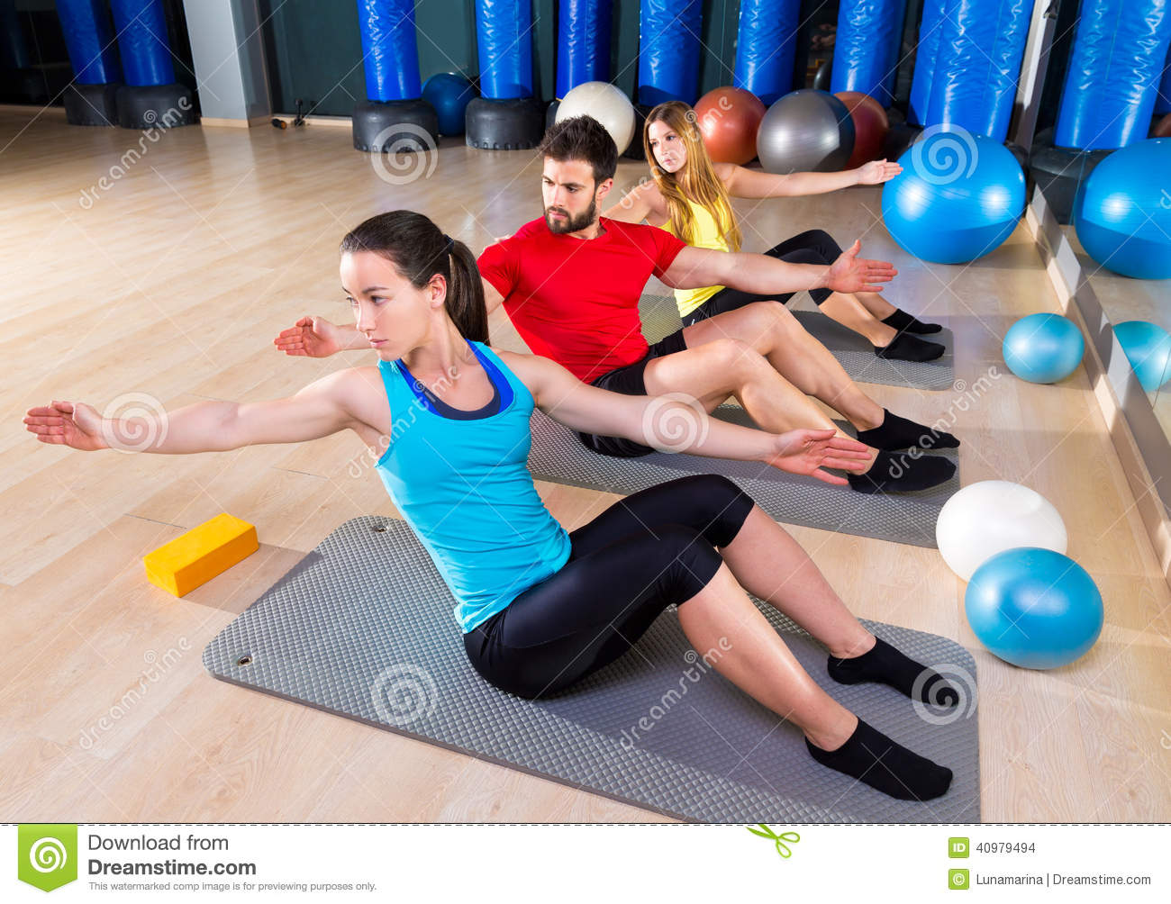 Pilates people group exercise man and women stock photo for Gimnasio pilates