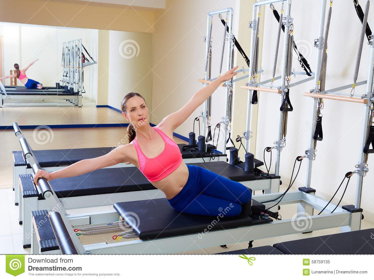 Pilates reformer woman mermaid exercise stock image for Gimnasio pilates