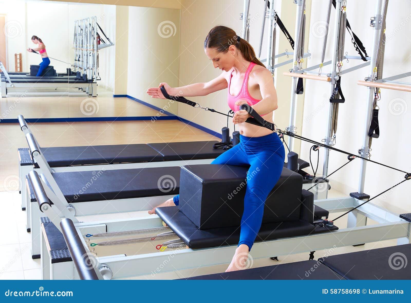 Pilates Reformer Woman Short Box Horse Back Stock Photo