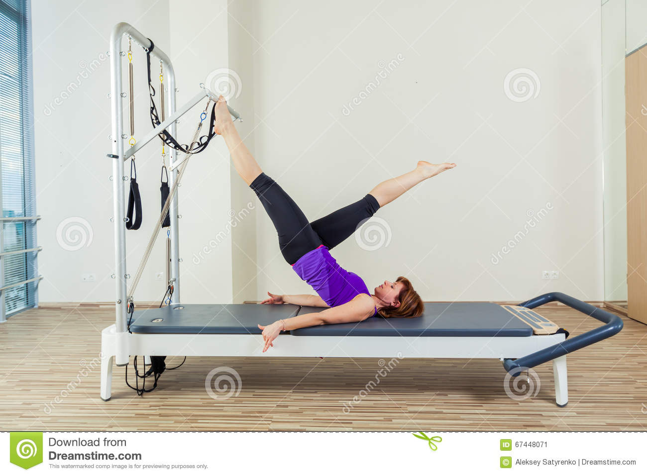 Cadillac pilates sport woman gym instructor stock image for Gimnasio pilates