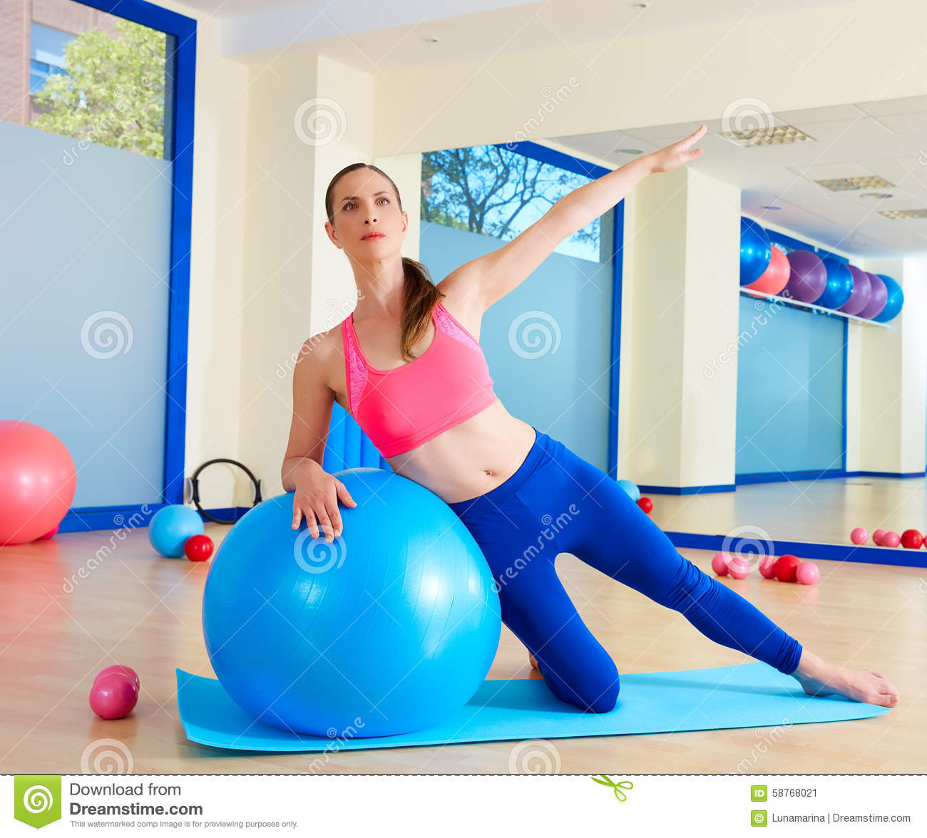 Woman Pilates Chair Exercises Fitness Stock Photo: Pilates Woman Side Bend Fitball Exercise Stock Photo