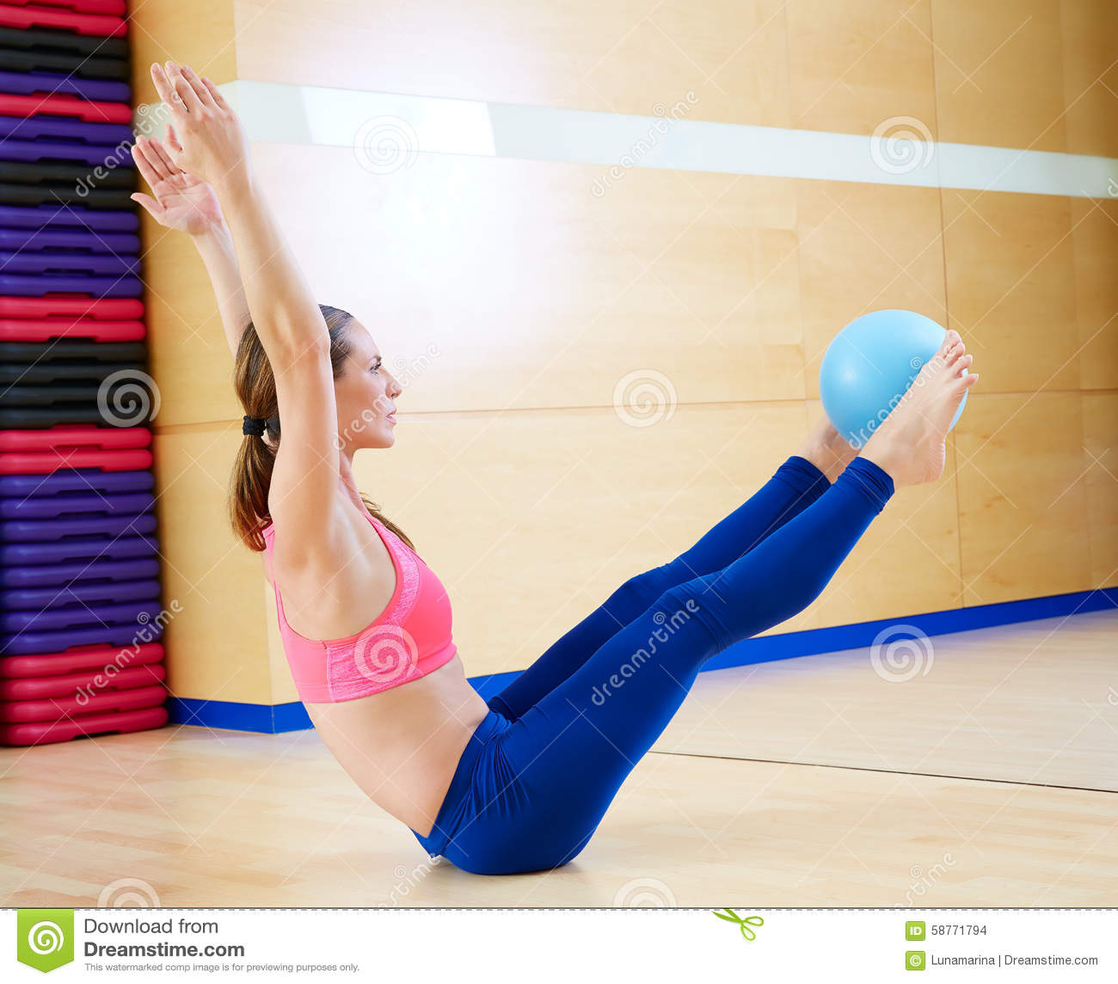 Woman Pilates Chair Exercises Fitness Stock Photo: Pilates Woman Stability Ball Teaser Exercise Stock Photo