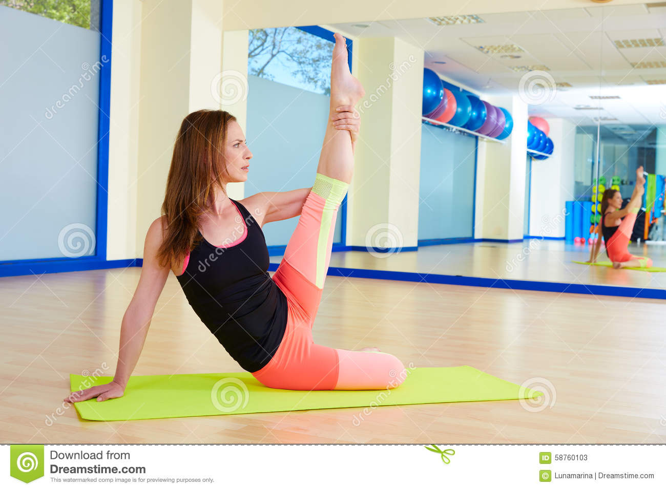 Pilates woman stretching exercise workout at gym royalty for Gimnasio pilates