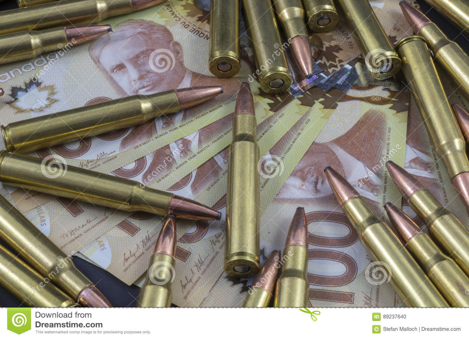 Pile of ammo on Canadian Money