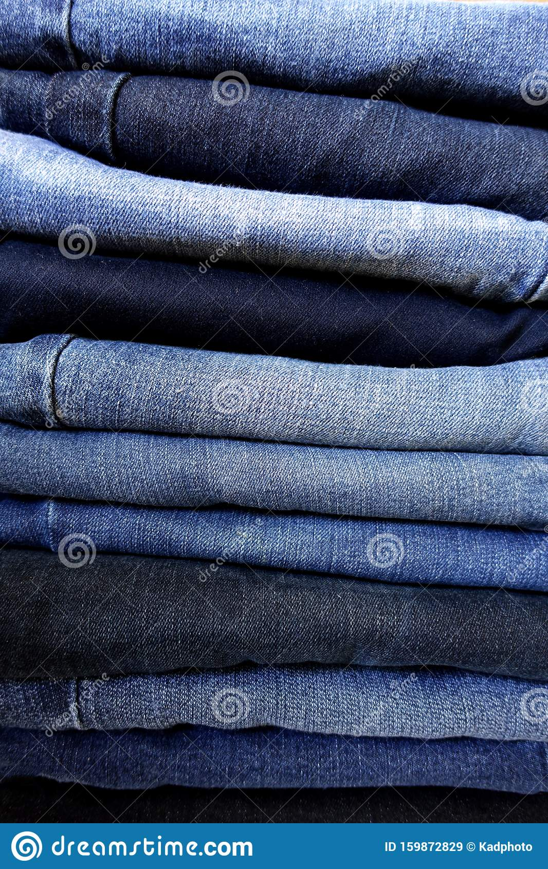 Stack of Blue Jeans - Varying Shades of Washed Denim