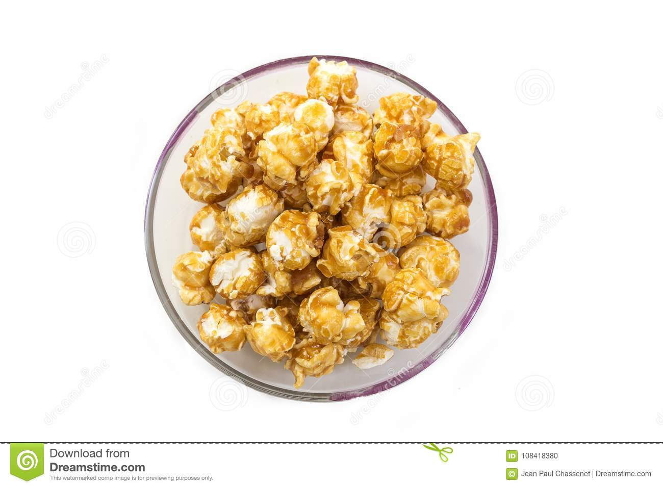 A pile of caramel corn in a bowl on a white background