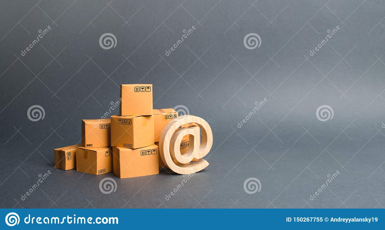 Pile of cardboard boxes and symbol commercial AT. shopping online. E-commerce. sales of goods and services through online trading