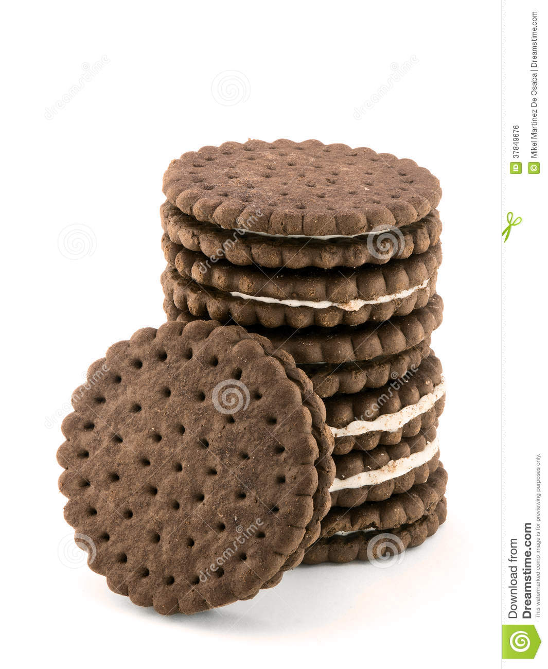 Pile of chocolate cream cookies isolated on white