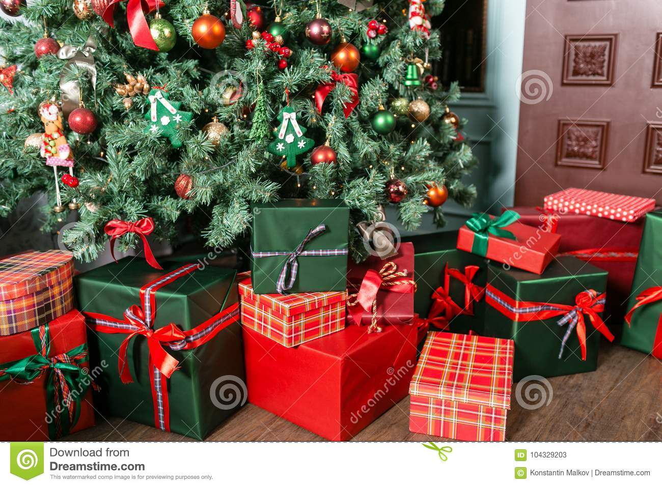 Pile Of Christmas Gifts Close-up Under The Christmas Tree. Red And ...