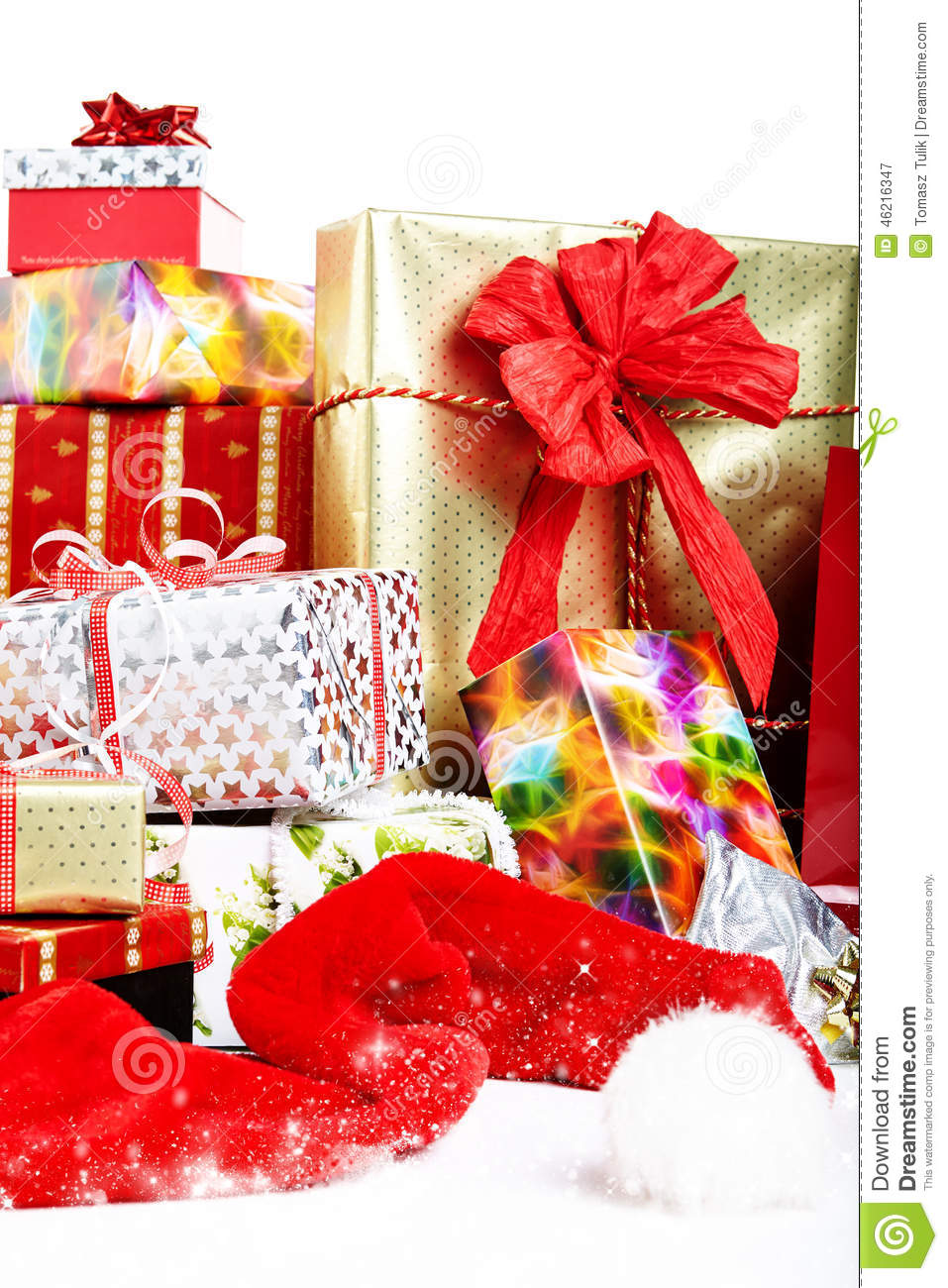 A Pile Of Christmas Gifts In Colorful Wrapping