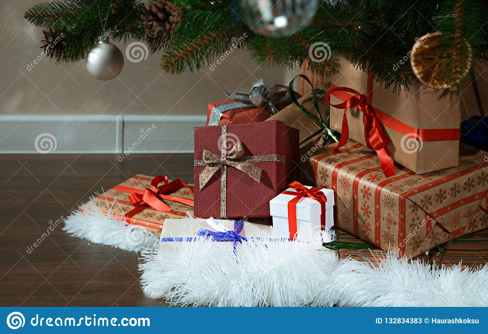 A Pile Of Christmas Presents Under The Tree New Year Background