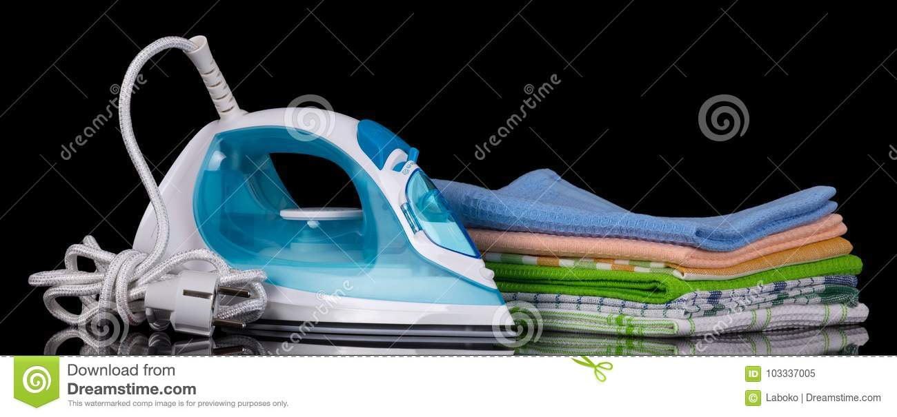 Pile Of Clean Kitchen Towels And The Device For Ironing Stock Image ...