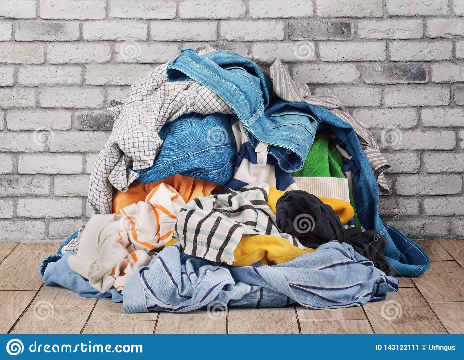 Pile of clothes on floor stock image  Image of domestic