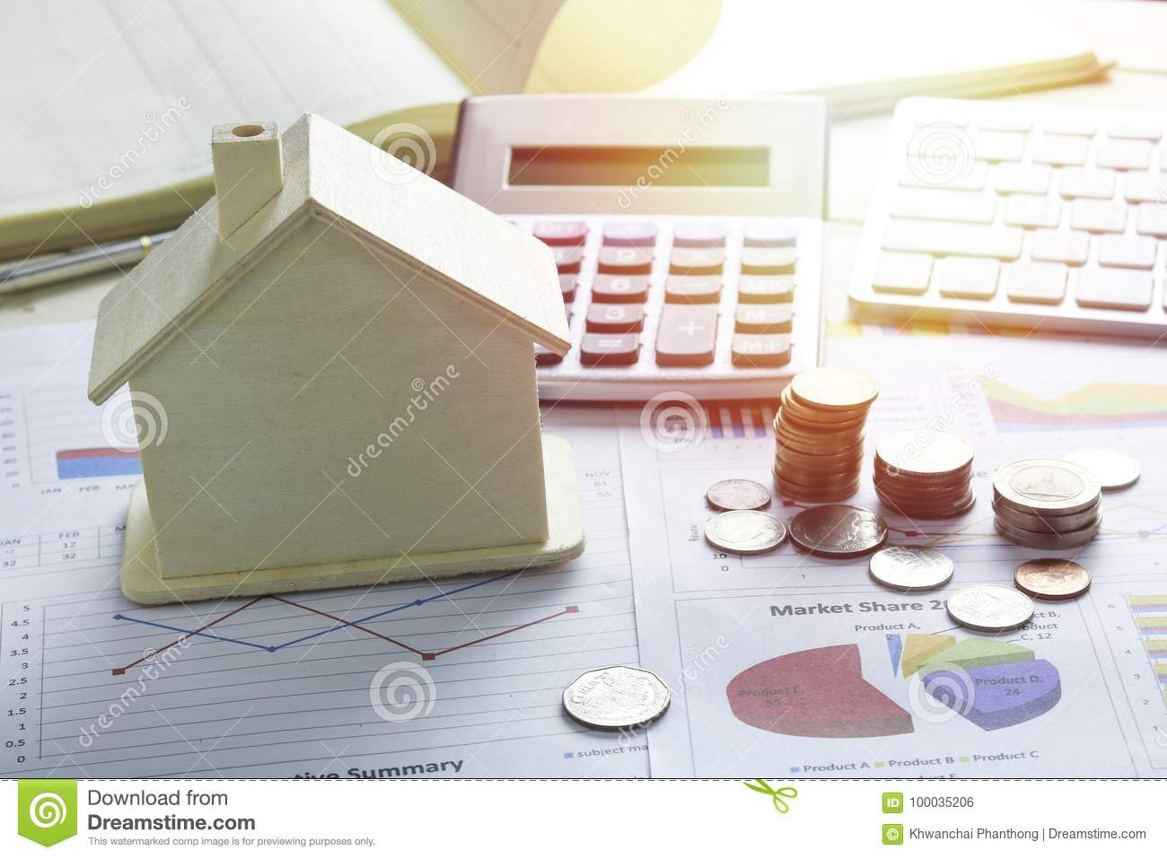 Pile Of Coins And Home, Concept In House Finance On Wood Stock Photo ...