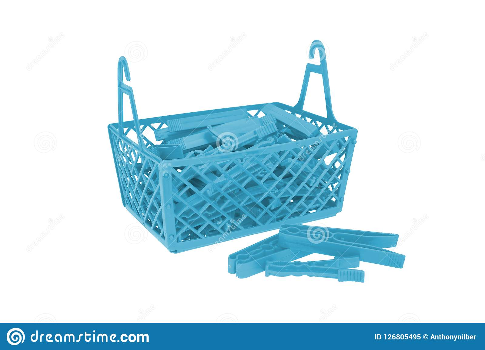 Pile of color plastic cloth clamps inside basket isolated on whi. Te Royalty Free Stock Photo
