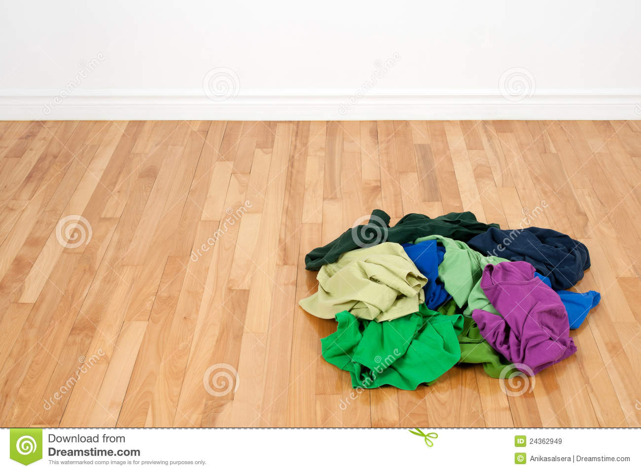 Pile of colorful clothes on the wooden floor royalty free for On the floor