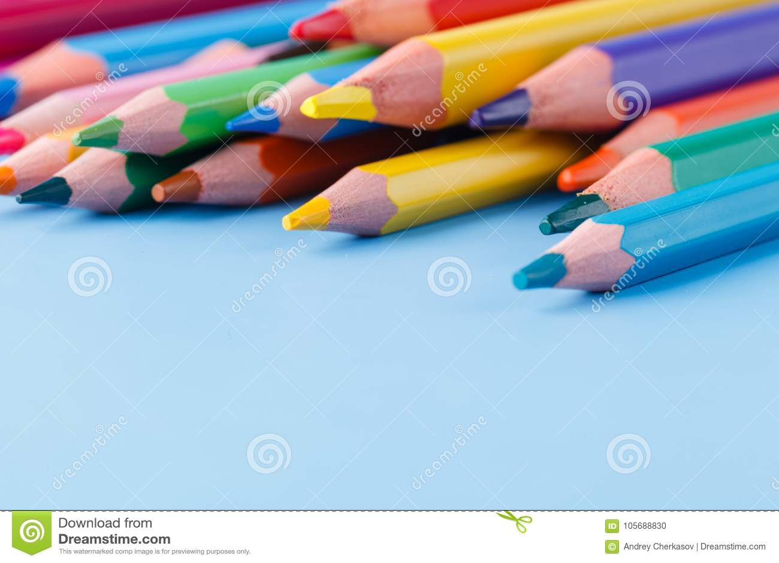 Pile Of Colour Pencils On Light Blue Background Creative Idea C