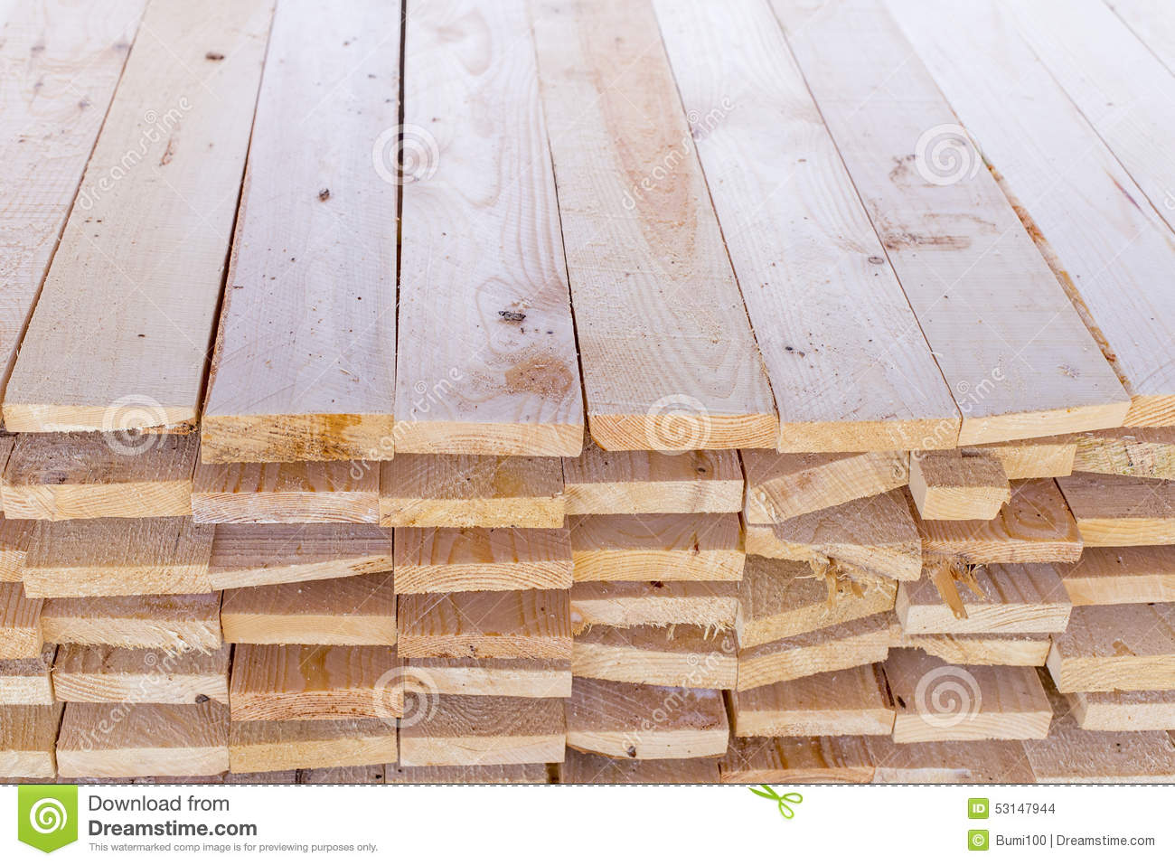 Pile of cut wood for construction texture stock photo