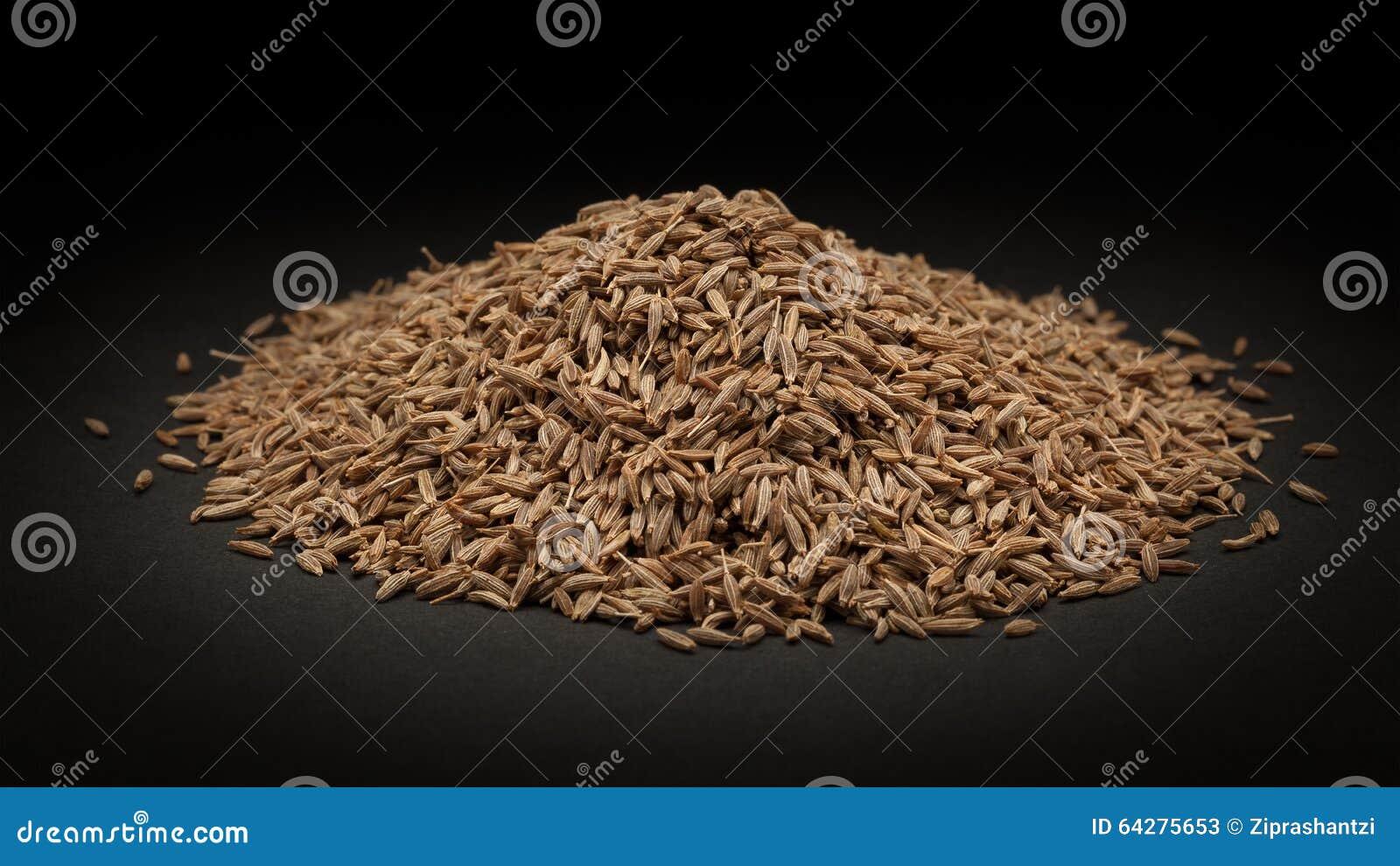 Pile de graine de cumin organique (cyminum de Cuminum)
