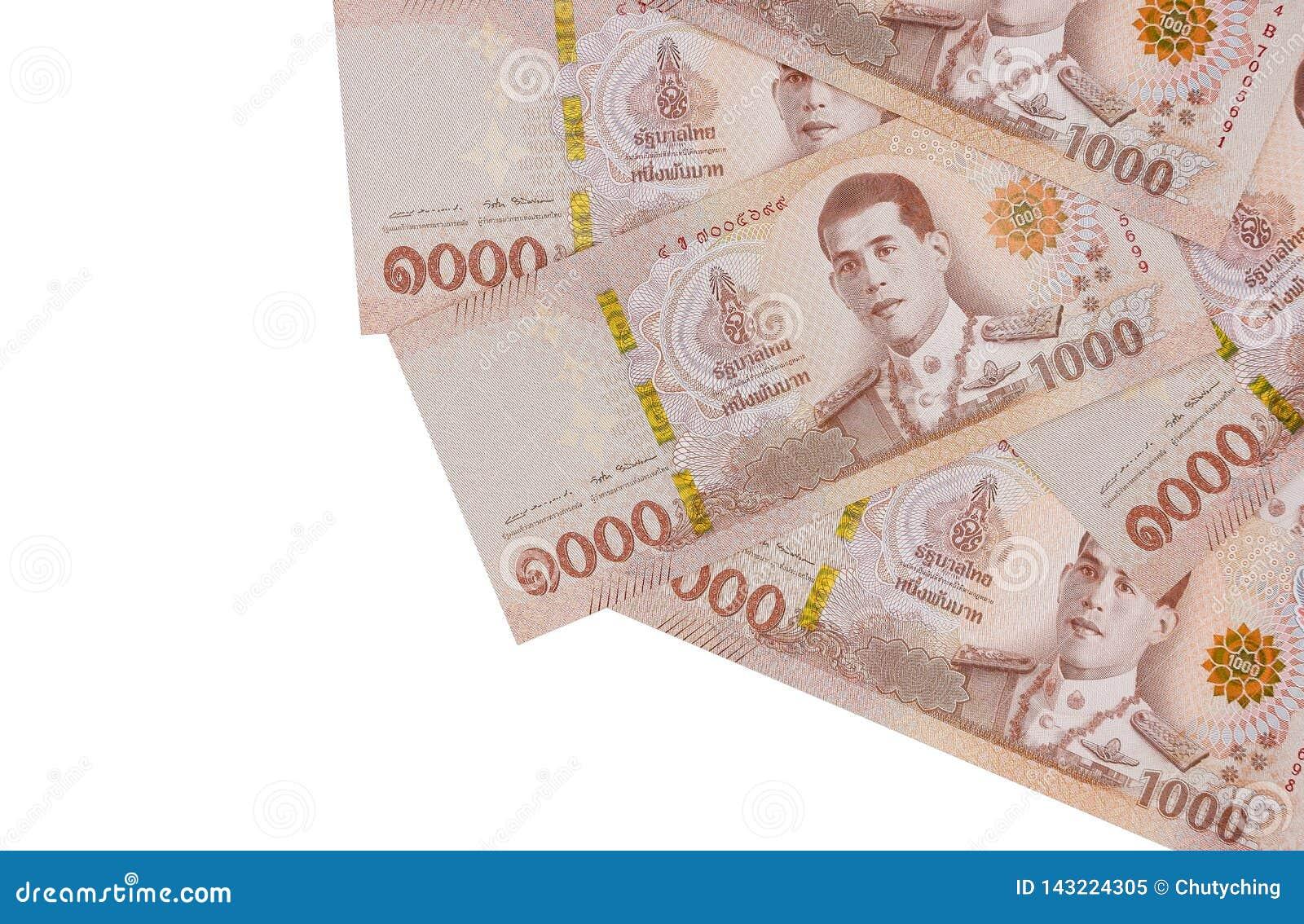 Pile de nouveaux mille billets de banque de baht thaïlandais