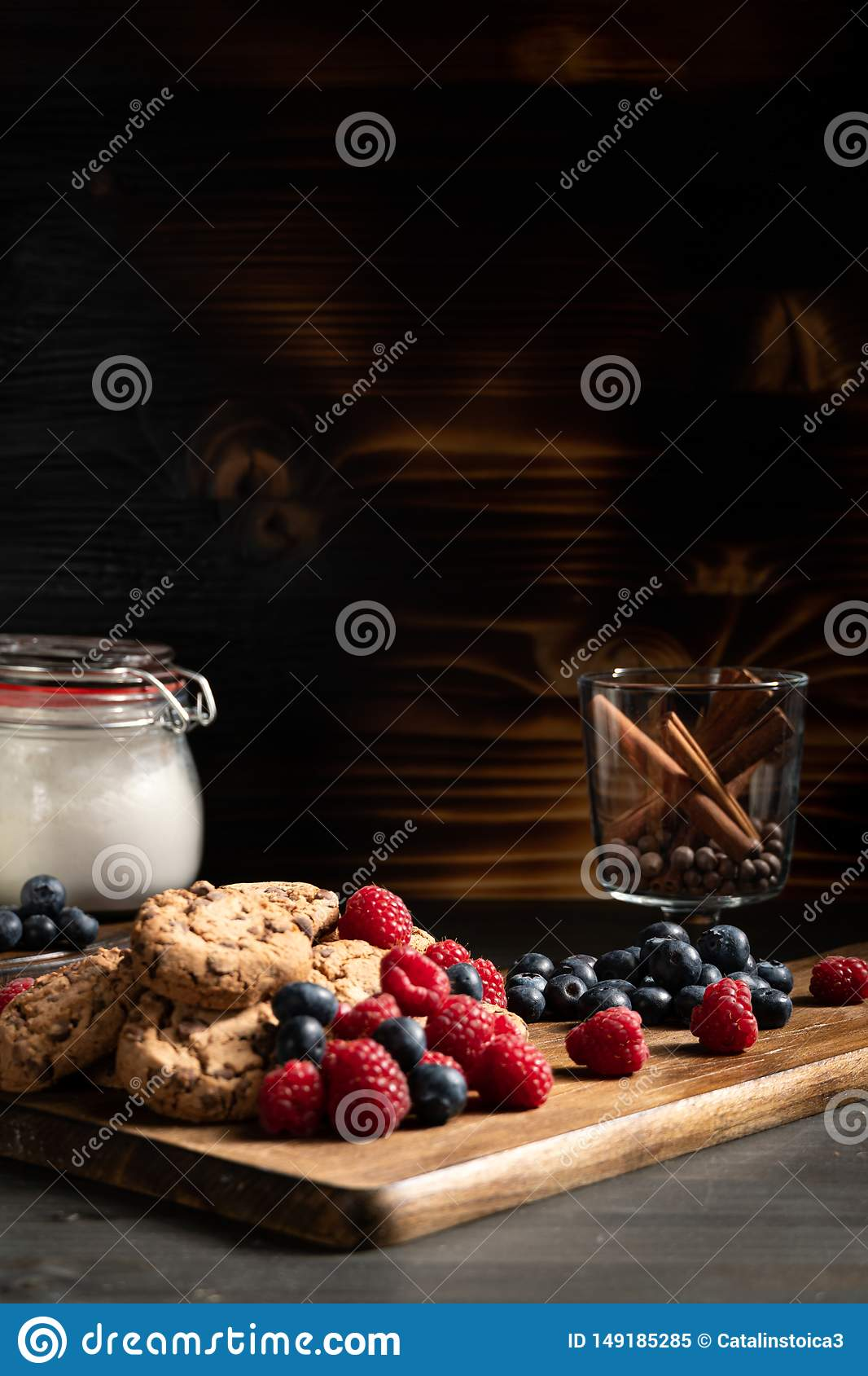 Pile of delicious biscuits on wooden board