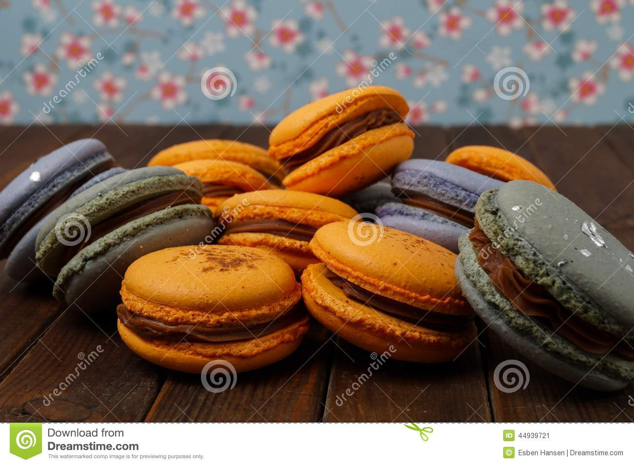 Pile of delicious blue and orange macaroons with ganache filling.